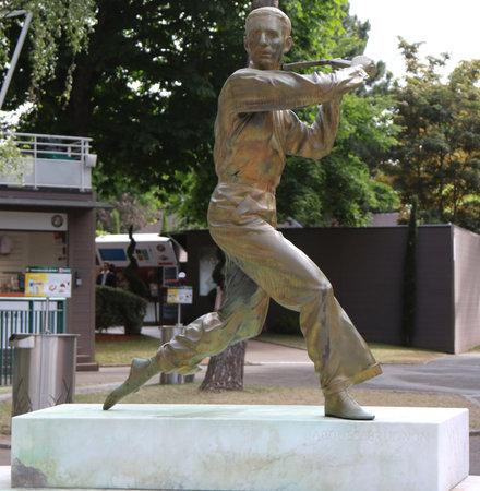 jacques: PARIS, FRANCE- MAY 29, 2015: Jacques Brugnon statue in Place des Mousquetaires at Le Stade Roland Garros in Paris, France