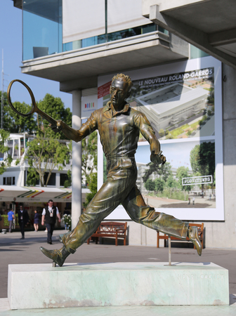 henri: PARIS, FRANCE- MAY 24, 2015: Henri Cochet statue in Place des Mousquetaires at Le Stade Roland Garros in Paris, France Editorial