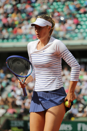 grand slam: PARIS, FRANCE- MAY 25, 2015:Five times Grand Slam champion Maria Sharapova in action during her first round match at Roland Garros 2015 in Paris, France Editorial
