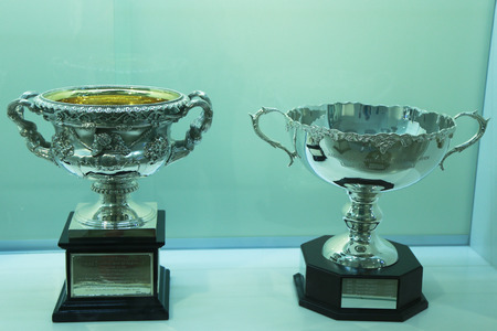 racket stadium: MELBOURNE, AUSTRALIA - JANUARY 28, 2016: Australian open trophies on display at Rod Laver Arena in Melbourne Park