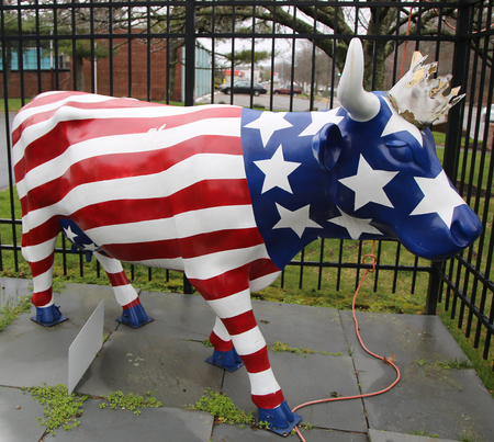 asher: BETHPAGE, NEW YORK - APRIL 10, 2016: American Royal painted cow sculpture by artist Asher Johnson from Make-A-Wish foundation in Bethpage, NY Editorial