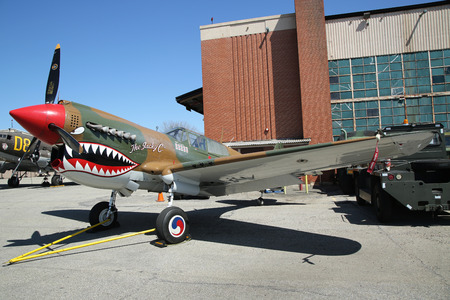airpower: FARMINGDALE, NEW YORK - APRIL 14, 2016: Curtiss P-40 Warhawk on display at the American Airpower Museum in Farmingdale,  New York.