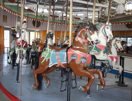 bb: BROOKLYN, NEW YORK - MAY 14, 2016: Horses on a traditional fairground B&B carousel at historic Coney Island Boardwalk in Brooklyn