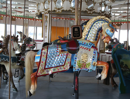centennial: BROOKLYN, NY - MAY 14, 2016: Historic Marcus Illions Horse on the B&B Carousel. The horse was carved in 1909, the same year the Lincoln penny was issued, in honor of the Centennial of Lincoln s birth Editorial