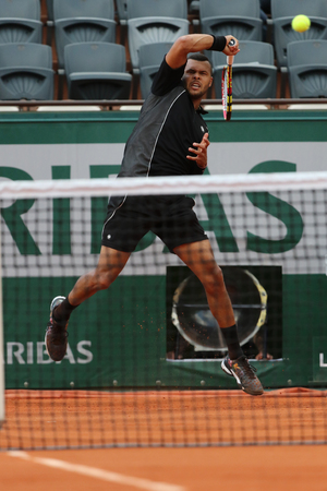 grand slam: PARIS, FRANCE- MAY 24, 2015: Professional tennis player Jo-Wilfried Tsonga of France in action during his first round match at Roland Garros 2015 in Paris, France
