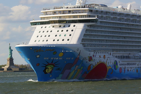 newest: NEW YORK - MAY 15, 2016: Norwegian Breakaway Cruise Ship leaving New York harbor. Norwegian Cruise Line Ship is the world s eighth largest cruise ship start voyages on May 12, 2013