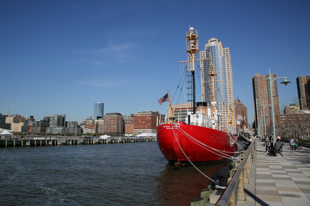 NEW YORK - APRIL 17, 2016: Nantucket Lightship docked in Lower Manhattan. The Lightship Nantucket or Nantucket Shoals was the name given to the light vessel that marked the hazardous Nantucket Shoals