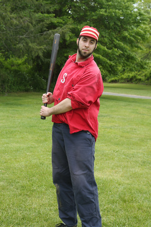 new rules: OLD BETHPAGE, NEW YORK - MAY 22, 2016: Baseball player in 19th century vintage uniform during old style base ball play following the rules and customs from 1864 in Old Bethpage Village Restoration Editorial