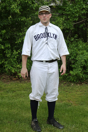 outfield: OLD BETHPAGE, NEW YORK - MAY 22, 2016: Baseball player in 19th century vintage uniform during old style base ball play following the rules and customs from 1864 in Old Bethpage Village Restoration Editorial