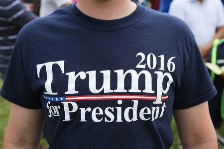 scheduled: BETHPAGE ,NEW YORK - MAY 22, 2016: Presidential candidate Donal Trump supporter wears t-shirt  with sign Trump 2016 for President. The US presidential election scheduled for Tuesday, November 8, 2016 Editorial