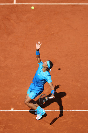 grand slam: PARIS, FRANCE- MAY 30, 2015: Fourteen times Grand Slam champion Rafael Nadal in action during his third round match at Roland Garros 2015 in Paris, France