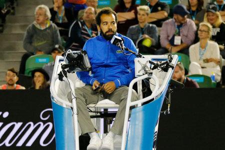 umpire: MELBOURNE, AUSTRALIA - JANUARY 24, 2016: Chair umpire Kader Nouni during Australian Open 2016 match at Rod Laver Arena in Melbourne Park
