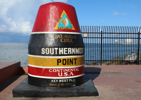 southernmost: KEY WEST, FLORIDA - JUNE 1, 2016: Famous Buoy sign marking the southernmost point in Continental United States in Key West, Florida