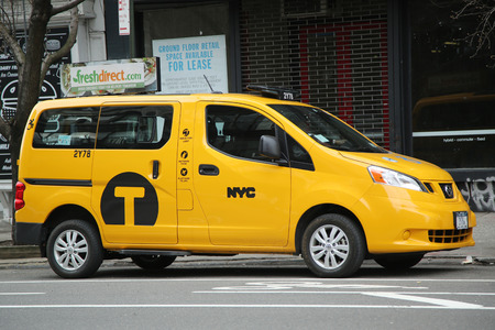specifically: NEW YORK -MARCH 10, 2016: New York City Taxi. The Nissan NV200 was designed specifically for use as a taxi in New York City and was named Taxi of Tomorrow