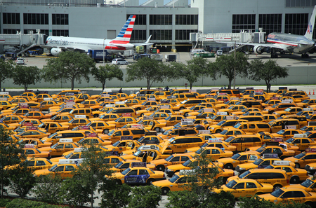 best travel destinations: MIAMI, FLORIDA - JUNE 1, 2016: Yellow taxis at Miami International Airport