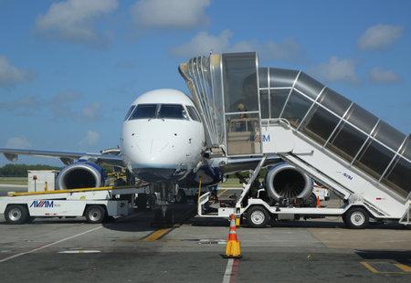 cana: PUNTA CANA, DOMINICAN REPUBLIC - JANUARY 4, 2016: Passenger jet on tarmac at Punta Cana International Airport Editorial