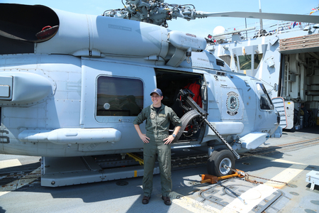 helicopter pilot: NEW YORK - MAY 26, 2016: Navy helicopter pilot in the front of Sikorsky MH-60R Seahawk on the deck of US guided missile destroyer USS Bainbridge during Fleet Week 2016 in New York