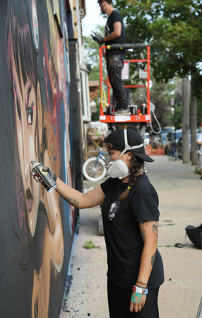 collective: NEW YORK, - JUNE 4, 2016: Unidentified street artist in gas mask during Bushwick Collective Block Party in Brooklyn, New York