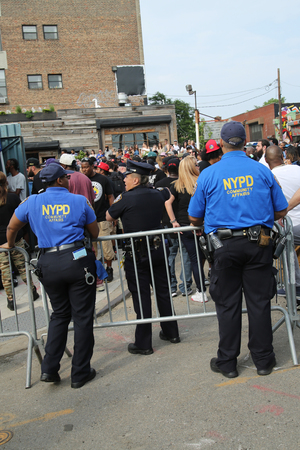 special service agent: NEW YORK - JUNE 4, 2016: NYPD and Community Affairs officers providing security at Hip Hop concert during  Bushwick Collective Block Party in Brooklyn Editorial