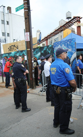 NEW YORK - JUNE 4, 2016: NYPD and Community Affairs officers providing security at Hip Hop concert during  Bushwick Collective Block Party in Brooklyn Sajtókép