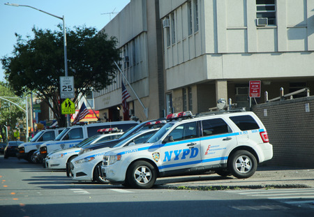 precinct: BROOKLYN, NEW YORK - JUNE 9, 2016: New York City Police Department cars at 81st Precinct in Brooklyn, New York. The New York Police Department, established in 1845, is the largest police force in USA