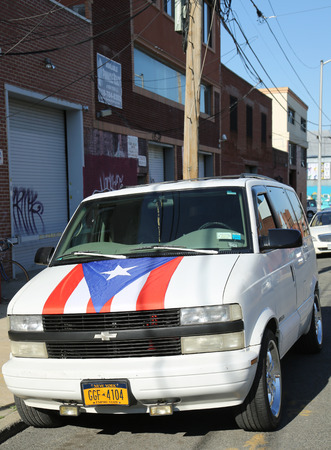 puerto rican flag: BROOKLYN, NEW YORK - JUNE 9, 2016: Van with Puerto Rican flag in Brooklyn, New York. The Puerto Rican Day Parade takes place annually in the United States along Fifth Avenue in Manhattan