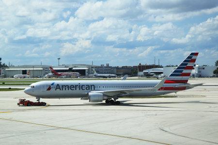 operates: MIAMI, FLORIDA - JUNE 1, 2016: American Airlines Boeing 767 on tarmac at Miami International Airport. American Airlines operates 274 flights every day from Miami Editorial
