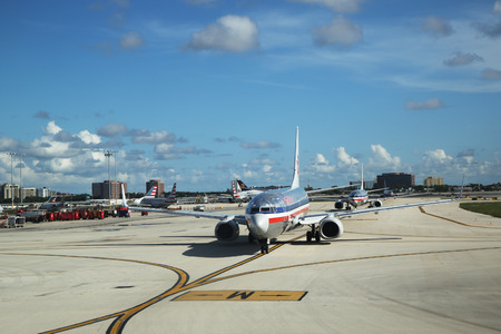 american airlines: MIAMI, FLORIDA - JUNE 1, 2016: American Airlines plane on tarmac at Miami International Airport. American Airlines operates 274 flights every day from Miami