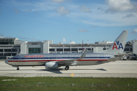 american airlines: MIAMI, FLORIDA - JUNE 1, 2016: American Airlines Boeing 737 plane on tarmac at Miami International Airport. American Airlines operates 274 flights every day from Miami Editorial