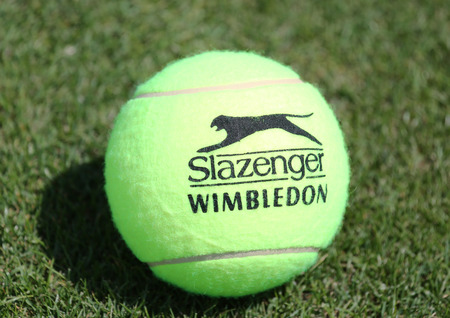 wimbledon: NEW YORK - AUGUST 6, 2015: Slazenger Wimbledon Tennis Ball on grass tennis court. Slazenger Wimbledon Tennis Ball exclusively used and endorsed by The Championships, Wimbledon