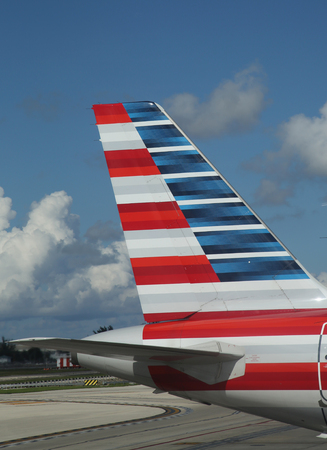 american airlines: MIAMI, FLORIDA - JUNE 1, 2016: American Airlines tailfin at Miami International Airport. American Airlines operates 274 flights every day from Miami