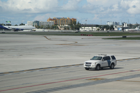 airport customs: MIAMI, FLORIDA - JUNE 1, 2016:US Department of Homeland Security US Customs and Border Protection car on tarmac at Miami International Airport.