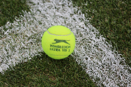 wimbledon: NEW YORK - JULY 21, 2015: Slazenger Wimbledon Tennis Ball on grass tennis court. Slazenger Wimbledon Tennis Ball exclusively used and endorsed by The Championships, Wimbledon