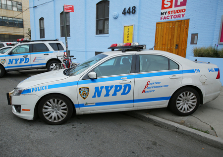 NEW YORK - JUNE 4, 2016: NYPD providing security at Hip Hop concert during Bushwick Collective Block Party in Brooklyn Sajtókép