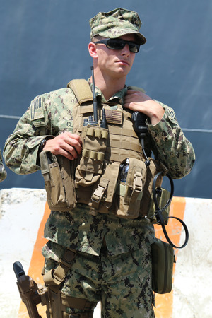 fleet: NEW YORK - MAY 26, 2016: Unidentified US Marine providing security during Fleet Week 2016 in New York
