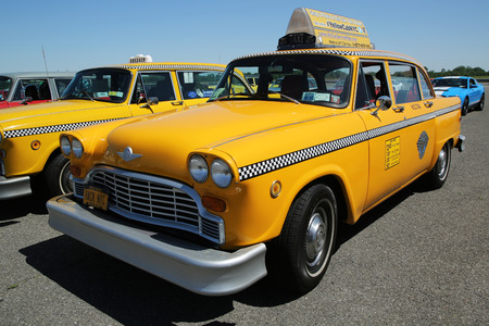 checker: BROOKLYN, NEW YORK - JUNE 12, 2016: Checker Taxi Cab produced by the Checker Motors Corporation on display at the Antique Automobile Association of Brooklyn annual Spring Car Show Editorial