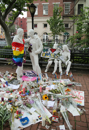 dangerous love: NEW YORK - JUNE 16, 2016: Memorial at Gay Liberation sculptures in Christopher Park  for the victims of the mass shooting in Pulse Club, Orlando in New York City