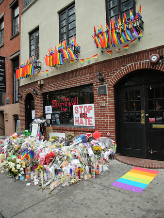 NEW YORK - JUNE 16, 2016: Memorial outside the gay rights landmark Stonewall Inn for the victims of the mass shooting in Pulse Club, Orlando in New York City