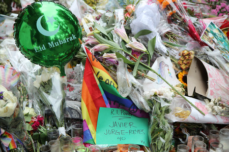 dangerous love: NEW YORK - JUNE 16, 2016: Memorial outside the gay rights landmark Stonewall Inn for the victims of the mass shooting in Pulse Club, Orlando in New York City