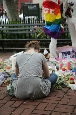 christopher: NEW YORK - JUNE 16, 2016: Mourners honor Orlando massacre victims at the Gay Liberation Memorial in Christopher Park in New York City