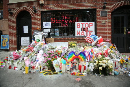 NEW YORK - JUNE 16, 2016: Memorial outside the rights landmark Stonewall Inn for the victims of the mass shooting in Pulse Club, Orlando in New York City