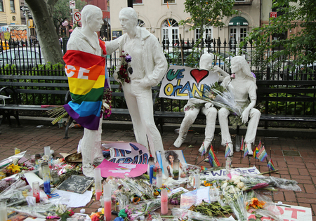dangerous love: NEW YORK - JUNE 16, 2016: Memorial at Gay Liberation sculptures in Christopher Park for the victims of the mass shooting in Pulse Club, Orlando in New York City Editorial