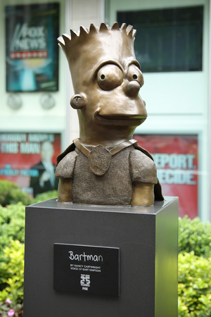 simpson: NEW YORK - JUNE 16, 2016: Statue of Bart Simpson in front of the Newscorp Building in New York.