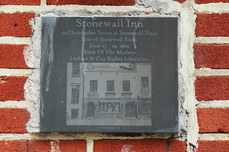 dangerous love: NEW YORK - JUNE 16, 2016: Sign at the gay rights landmark Stonewall Inn in New York City. It is a birthplace of the modern lesbian and gay rights liberation.