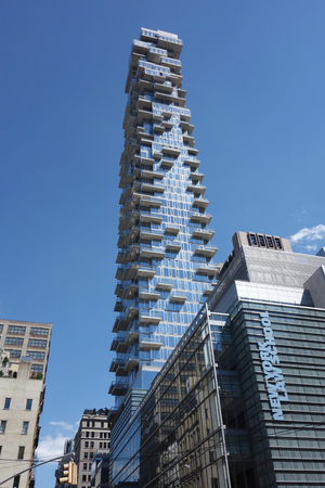 gentrification: NEW YORK - JUNE 22, 2016: Nearly completed 60-story building a k a the Jenga Tower at 56 Leonard Street in Tribeca, Lower Manhattan.