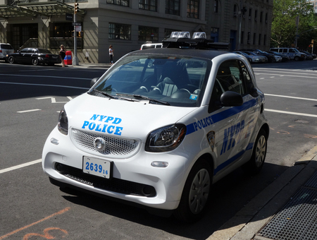 smallest: NEW YORK - JUNE 22, 2016: NYPD smallest car Smart ForTwo in Lower Manhattan.
