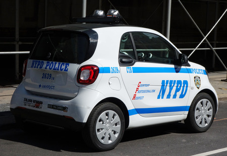 new world order: NEW YORK - JUNE 22, 2016: NYPD smallest car Smart ForTwo in Lower Manhattan.