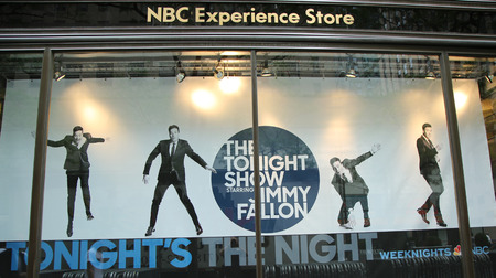 tonight: NEW YORK - JUNE 16, 2016: NBC Experience Store window display decorated with The Tonight Show with Jimmy Fallon logo in Rockefeller Center in Midtown Manhattan