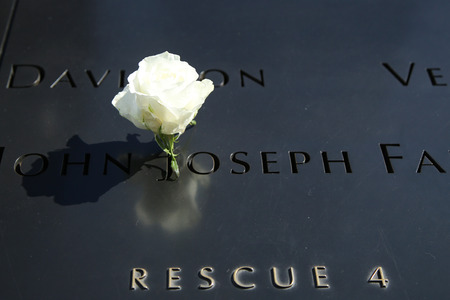 NEW YORK - MARCH 6, 2016: Flower left at the National 911 Memorial at Ground Zero in Lower Manhattan
