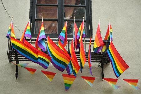 NEW YORK - JUNE 16, 2016: Rainbow flags outside the gay rights landmark Stonewall Inn in New York City